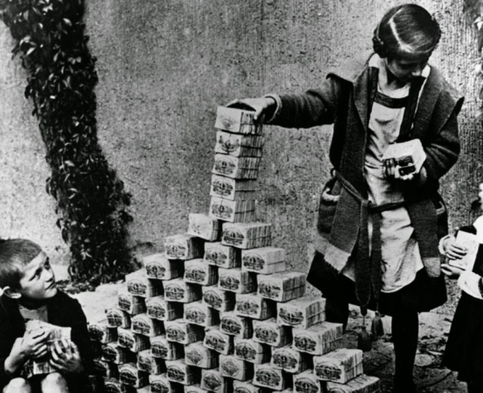 Children playing with stacks of hyperinflated currency during the Weimar Republic, 1922